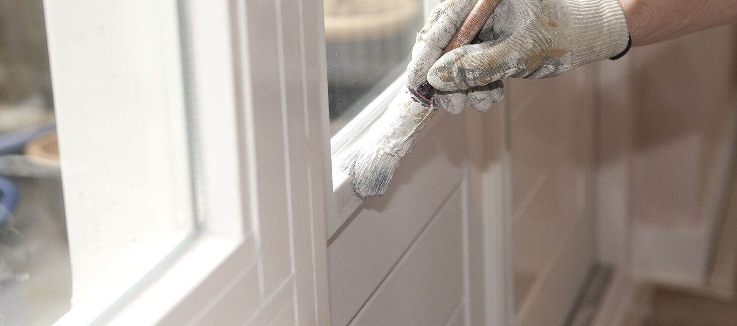 stock-photo-hand-with-paintbrush-painting-a-door-white-95773408